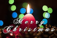 Merry Christmas card bokeh background. Merry Christmas card with blue and green bokeh background, red candle, flame and light Royalty Free Stock Photo