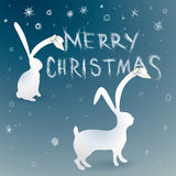 Merry Christmas card with bunnies Royalty Free Stock Photos