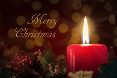 Merry Christmas Card with Burning Candle Royalty Free Stock Images