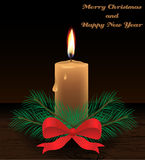 Merry Christmas card with candle Stock Photography