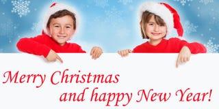 Merry Christmas card children kids Santa Claus pointing happy Ne stock image
