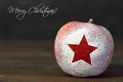 Merry Christmas card with Christmas apple Royalty Free Stock Image
