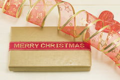 Merry Christmas card with Christmas present and red ribbon Stock Photos