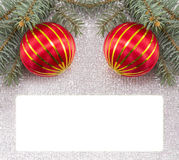 Merry Christmas card decorated with Christmas ornaments and fir Stock Images
