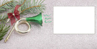 Merry Christmas card decorated with toy horn and fir tree Stock Photos