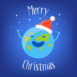 Merry Christmas Card with fun Earth in a Santa hat and snow on blue background. Vector illustration Royalty Free Stock Photography