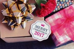 Merry Christmas card with gift. Royalty Free Stock Photo