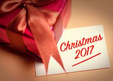 Merry Christmas card with gift. Stock Photo