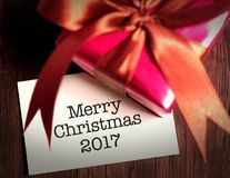 Merry Christmas card with gift. Royalty Free Stock Photos