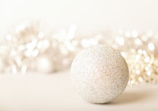 Merry christmas card. Golden glitter ball on golden background. Christmas and new year card Stock Photo