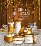 Merry Christmas card. Golden wrapped gift boxes. Stock Photos