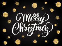 Merry christmas card with hand drawn lettering and golden glitter dots Royalty Free Stock Image