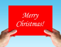 Merry Christmas Card. In hands on blue background stock images