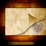Merry christmas card, heart on parchment Royalty Free Stock Image