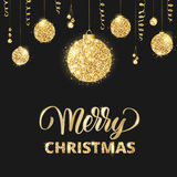 Merry Christmas card with lettering and glitter decoration. Hanging golden balls, ribbons Royalty Free Stock Photo