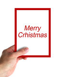Merry Christmas card message. Hand hold a big card with text Merry Christmas. isolated on white stock photos