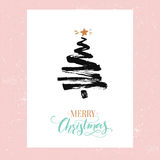 Merry Christmas card, minimalism design. Simple sketched fir tree and calligraphy text Merry Christmas. Black ink and. Gold colors at pink background Royalty Free Stock Image