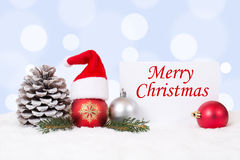 Merry Christmas card with ornaments, balls, hat decoration Stock Image