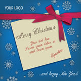 Merry Christmas card. A paper Merry Christmas card bounded by a red bow over a blue snowy texture background. Vector illustration Royalty Free Stock Image