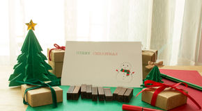 Merry christmas card,paper christmas tree with presents, pines a Royalty Free Stock Photos