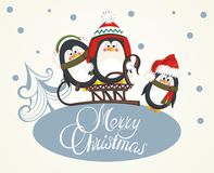 Merry Christmas card with penguins Royalty Free Stock Photo