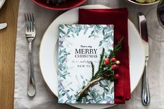 Merry Christmas Card On Plate Between Fork And Knife Stock Photography