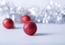 Merry christmas card. Red glitter balls on silver background. Christmas and new year card Royalty Free Stock Images