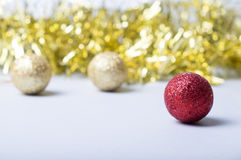 Merry christmas card. Red and golden glitter balls on golden background. Christmas and new year card Royalty Free Stock Photos