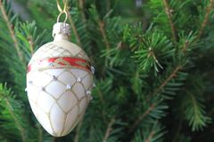 Merry christmas card with white ornaments. On the xmas tree Royalty Free Stock Photo