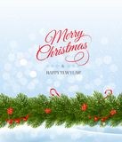 Merry Christmas card with a ribbon and christmas tree branch. Stock Image