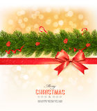 Merry Christmas card with a ribbon and christmas tree branch. Royalty Free Stock Photos