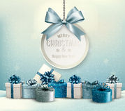 Merry Christmas card with a ribbon and gift boxes. Stock Photo