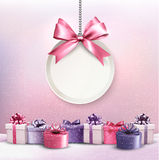 Merry Christmas card with a ribbon and gift boxes. Stock Image