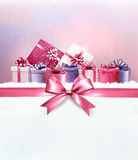 Merry Christmas card with a ribbon and gift boxes. Royalty Free Stock Photo