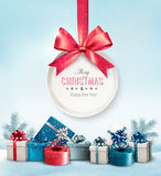 Merry Christmas card with a ribbon and gift boxes. Royalty Free Stock Images