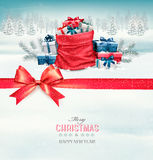 Merry Christmas card with a ribbon and gift boxes. Stock Images