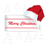 Merry Christmas card with Santa Claus Cap stock photo