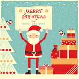 Merry christmas card with Santa Claus and presents Stock Images