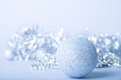 Merry christmas card. Silver glitter ball on silver background. Christmas and new year card Stock Photos