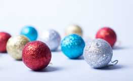 Merry christmas card. Silver, golden, blue and red glitter balls on silver background. Christmas and new year card Stock Images