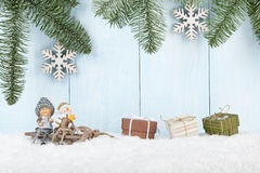Merry Christmas card. With smiling figurines on the sled and gift boxes Royalty Free Stock Images