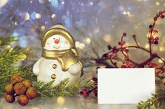 Merry Christmas card: Snowman and Christmas star Stock Photos