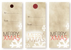 Merry Christmas card templates. In vertical format with space for text or your seasonal message with falling snowflakes on a beige background Stock Photo