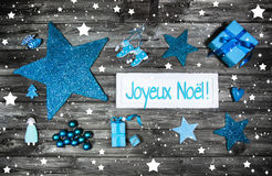 Merry christmas card or voucher. Xmas decoration in blue, white. On grey wooden background with french greetings Stock Photography