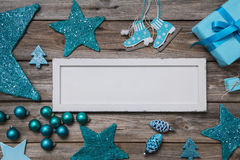 Merry christmas card in white and turquoise colores. Merry christmas card in white and turquoise colores with a wooden sign Stock Images