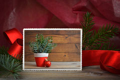 Merry Christmas card. On wooden background Stock Photo