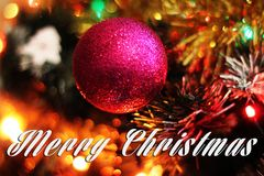 Merry Christmas card with red ball and colorful bokeh background Royalty Free Stock Photos