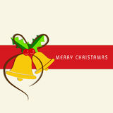 Merry Christmas celebration greeting card with jingle bell. Stock Photo