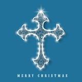 Merry Christmas celebration with shiny cross. Royalty Free Stock Photo