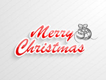 Merry Christmas celebration stylish text with x-mas ball. Royalty Free Stock Image